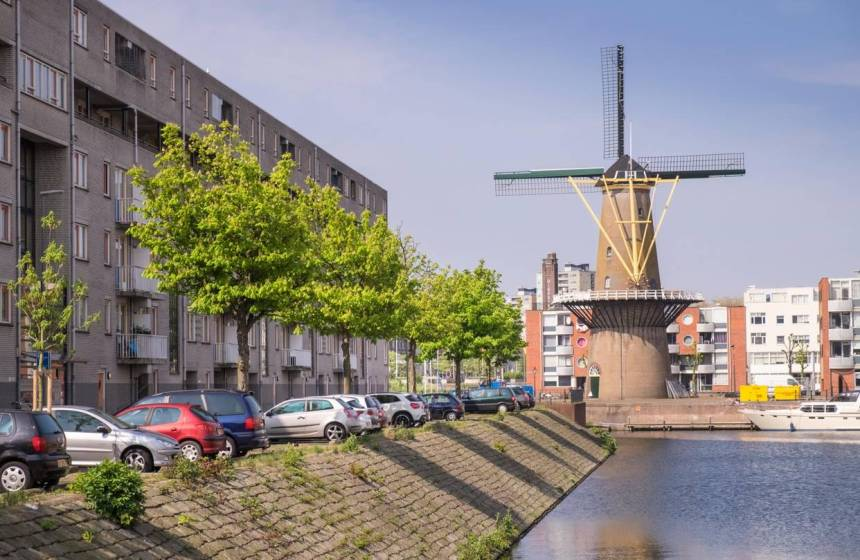 A dike and a windmill in Rotterdam, a city already prone to floods.