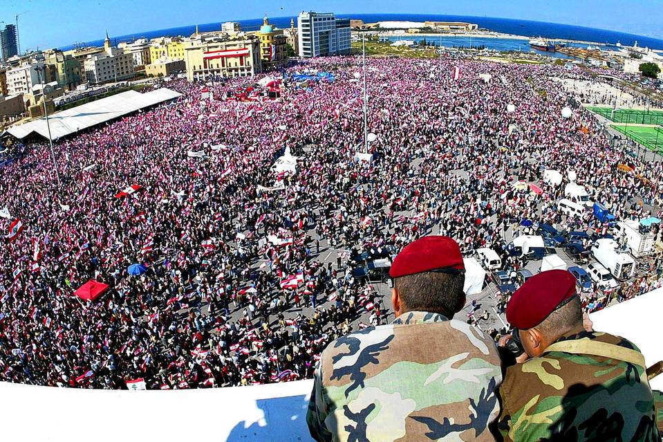 Two Lebanese soldiers watch as hundreds of thousands of demonstrators fill Beirut's Martyrs Square on March 14, 2005.