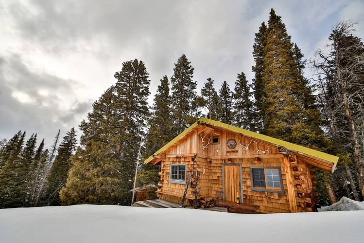 "While a new owner could build more cabins of 1,000 square feet each, the area is zoned ""rural and remote,"" which prohibits building larger houses."