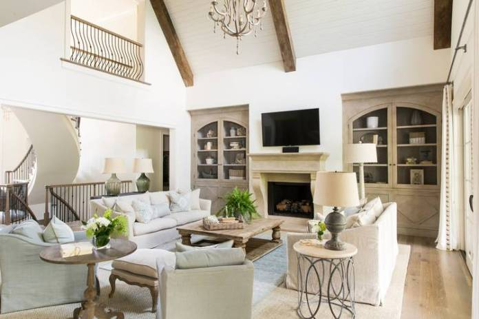The Bocians' family room has a vaulted ceiling with beams made of reclaimed wood.