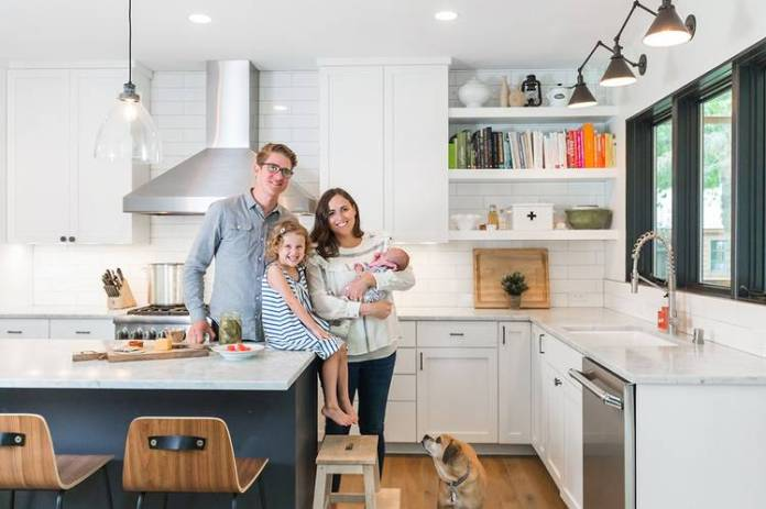 Ted and Nicole Abramson with daughters Sawyer, 3, and Quinn, 6 weeks. The house's current design resulted from a $620,000 renovation completed in 2016.