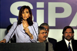 Argentina's President Cristina Fernandez de Kirchner speaks next to Economy Minister Carlos Fernandez (R) at the National Social Security Administration in Buenos Aires on Monday.