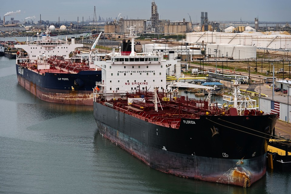 Oil tankers are loaded with crude in Corpus Christi, Texas, in December. The area has prospered in recent years due to the energy boom in the Eagle Ford shale formation, but falling prices could test that.