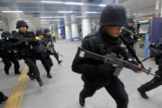 Associated Press South Korean police officers run through a Seoul subway station Tuesday in an antiterrorism exercise ahead of next week's nuclear-security summit.