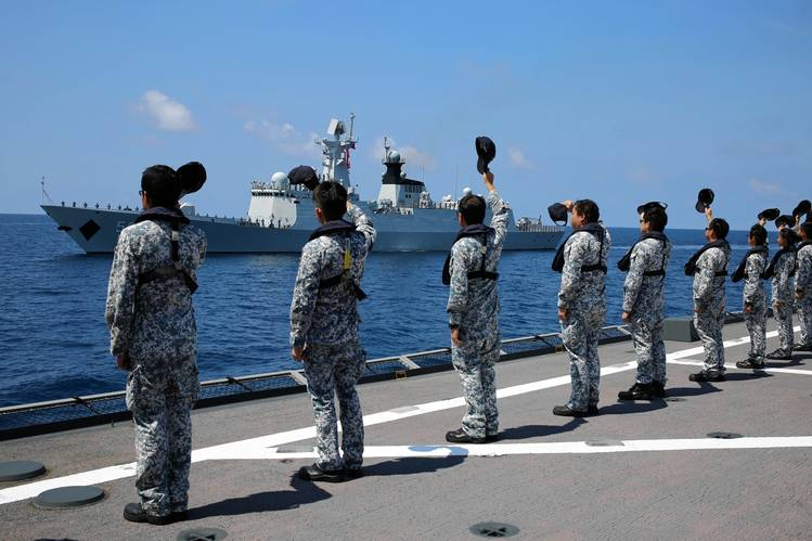 A Chinese navy frigate conducts exercises in the South China Sea.