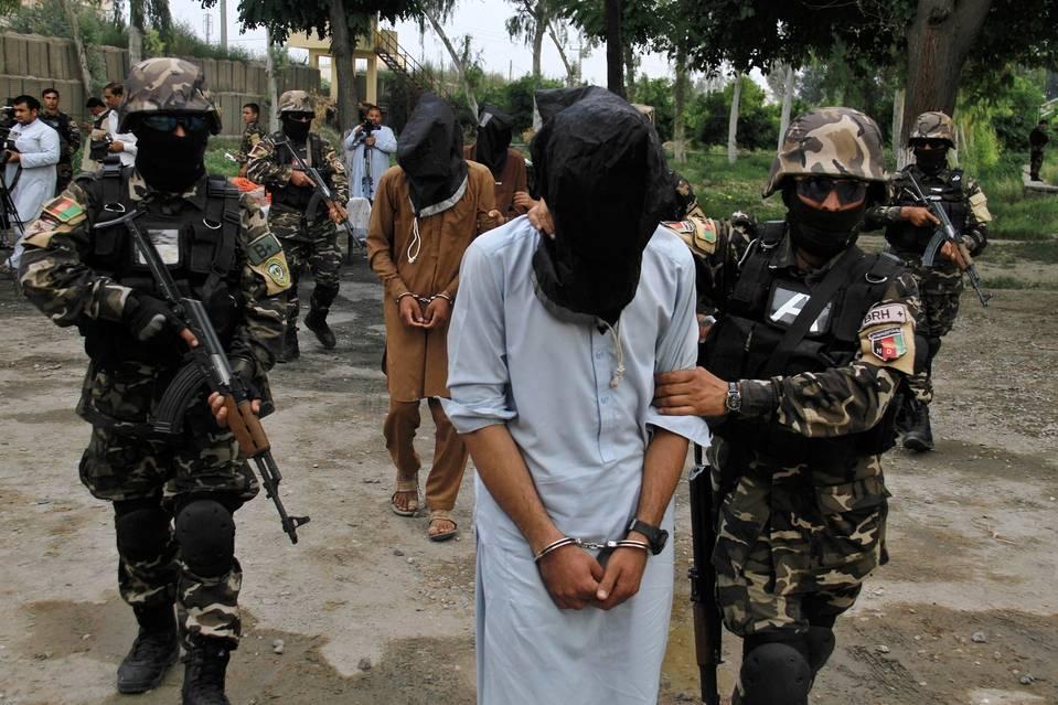 Afghan security officials last month escorted suspected Taliban militants after arresting them in Jalalabad, Afghanistan.