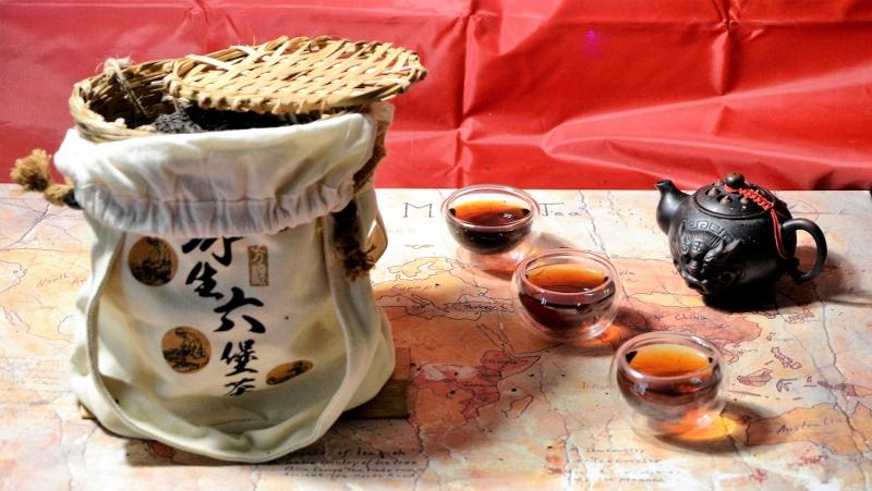Liu Bao Dark Tea - Guangxi Hei Cha, stored for ripening in a woven bamboo basket wrapped in a jute sack
