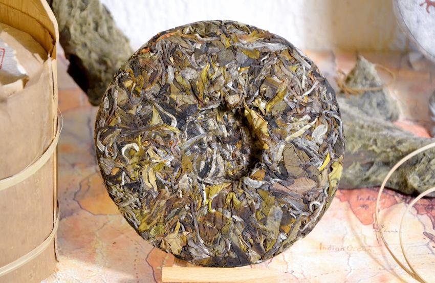 unwrapped tea cake (Ming Feng Shan Gushu Bai Lu White Pu Erh Tea) - back side