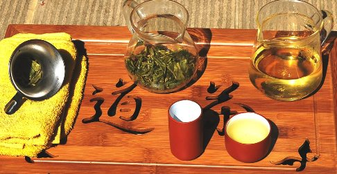 Exploring Wild Spring Long Jing Green Tea in a glass pot setting