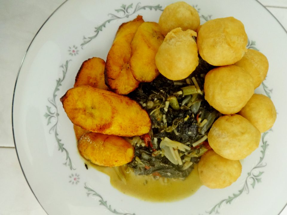 Fried Dumplings with Steamed Callaloo and fried ripe plantain