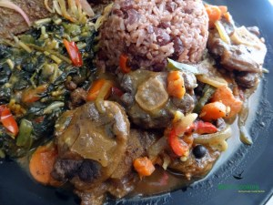 braised oxtail with rice and peas and steamed callaloo