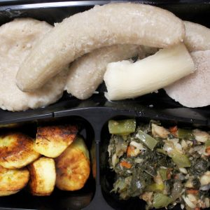 callaloo and saltfish with ground provisions and boiled dumpling
