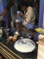 Waiting for a mango and coconut Lassi near the burning ghat