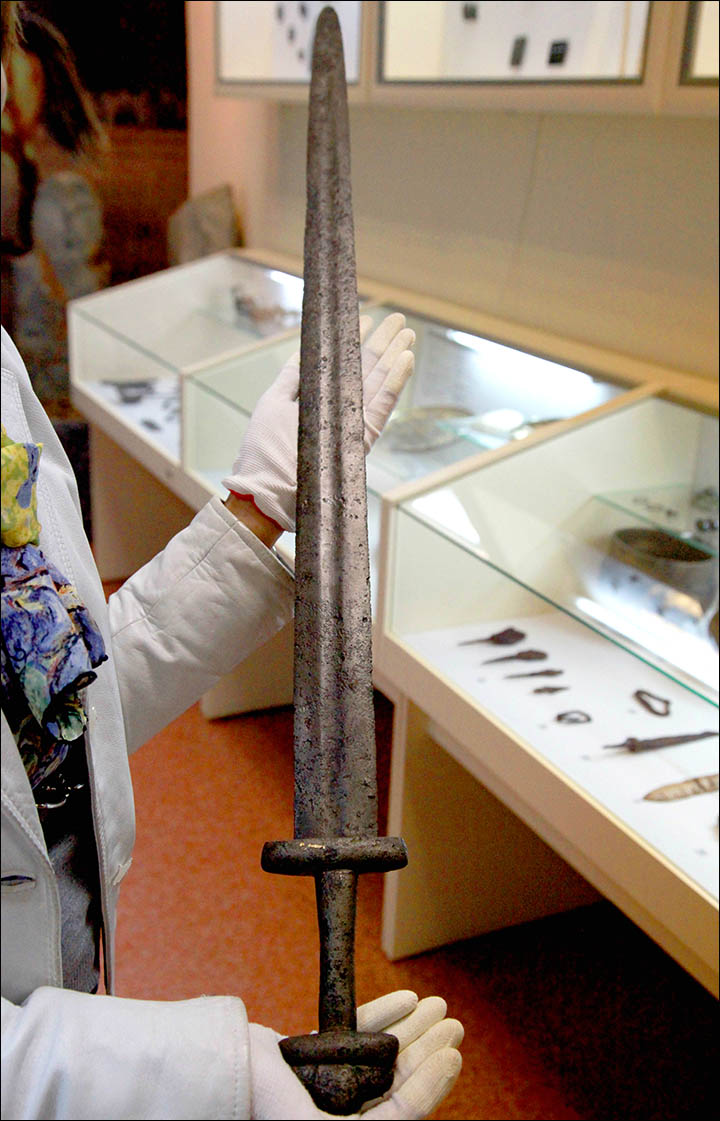The medieval sword was discovered buried under a tree in Novosibirsk region, and scientists are keen to unlock its secrets.