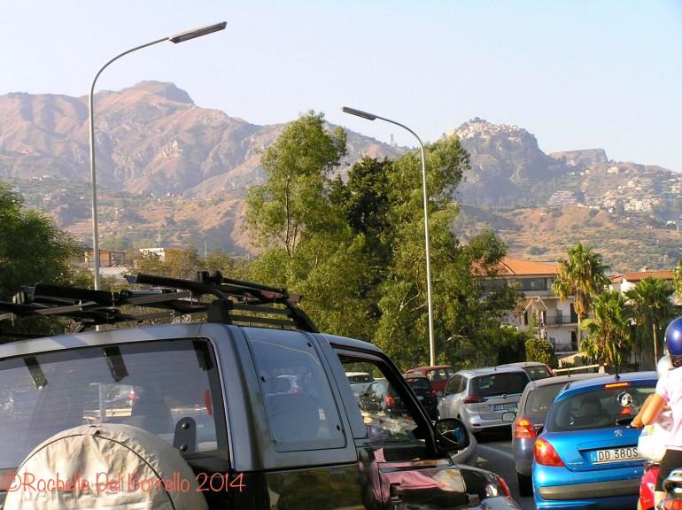 Ferragosto Traffic, with a view of Castel Mola and Taormina on the way to Giardini Naxos, Messina.