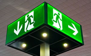 Emergency exit sign, cube light on ceiling, concept