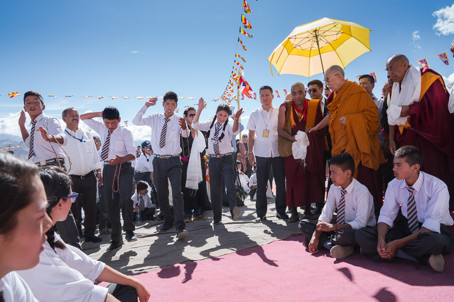 Students performing traditional, philosophical debate for His Holiness as he walks the red carpet in the main courtyard of the school.