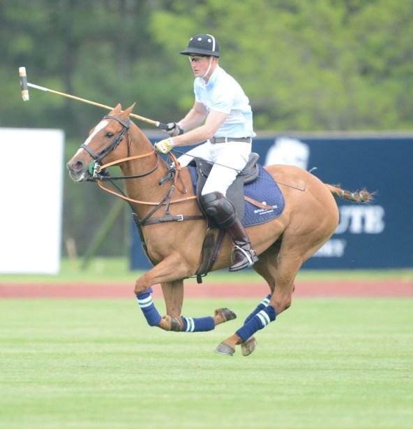 Prince Harry shows off his royal polo skills. Photo by John Robben