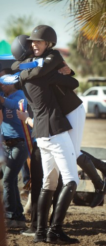 Nayel hugging and congratulating his good friend Ashlee Bond Clarke following their winning rounds at the AIG $1 Million Grand Prix at HITS Thermal.