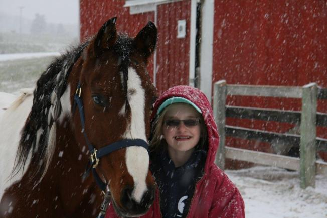 Seppy and Karissa after a ride in the snow.  (Photo courtesy of Lorie Hagl)