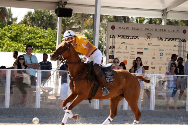 Kerstie takes part in the beach polo action. (Photo by Sheryel Aschfort, The Polo Papparazzi)