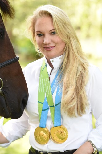 Marilyn Little with her team and individual eventing gold medals from the 2015 Pan Am Games in Canada.