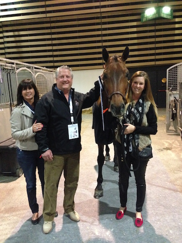 Meagan with her mom and dad at the 2014 World Cup Finals in Lyon, France. Photo courtesy of Meagan Nusz