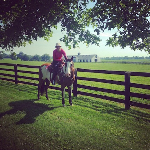 Meagan and Max, her first reining horse, enjoying a trail ride in Kentucky. Photo courtesy of Meagan Nusz