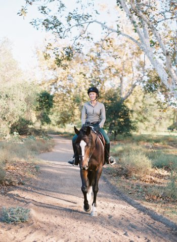 Susan and Knight enjoying a ride. Photo by Horses Who Love, horseswholove.com