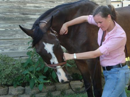 Grace adjusting her sister's horse, By The Book Photo courtesy of Grace Buchanan