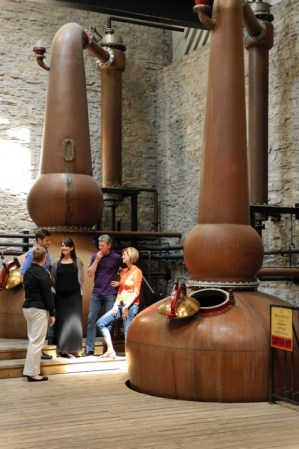 Visitors take a tour at historic Woodford Reserve Photo courtesy of VisitLex.com