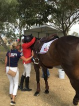 Phillip, hugging Mighty Nice, and wife Evie Dutton reacting to the news that they just won the individual bronze medal.  Photo by Caroline Moran