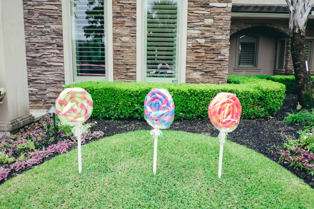 When guests arrived they entered to a driveway lined with lollipops that I made out of pool noodles, duct tape, PVC pipe, and cellophane (tutorial on this to come).