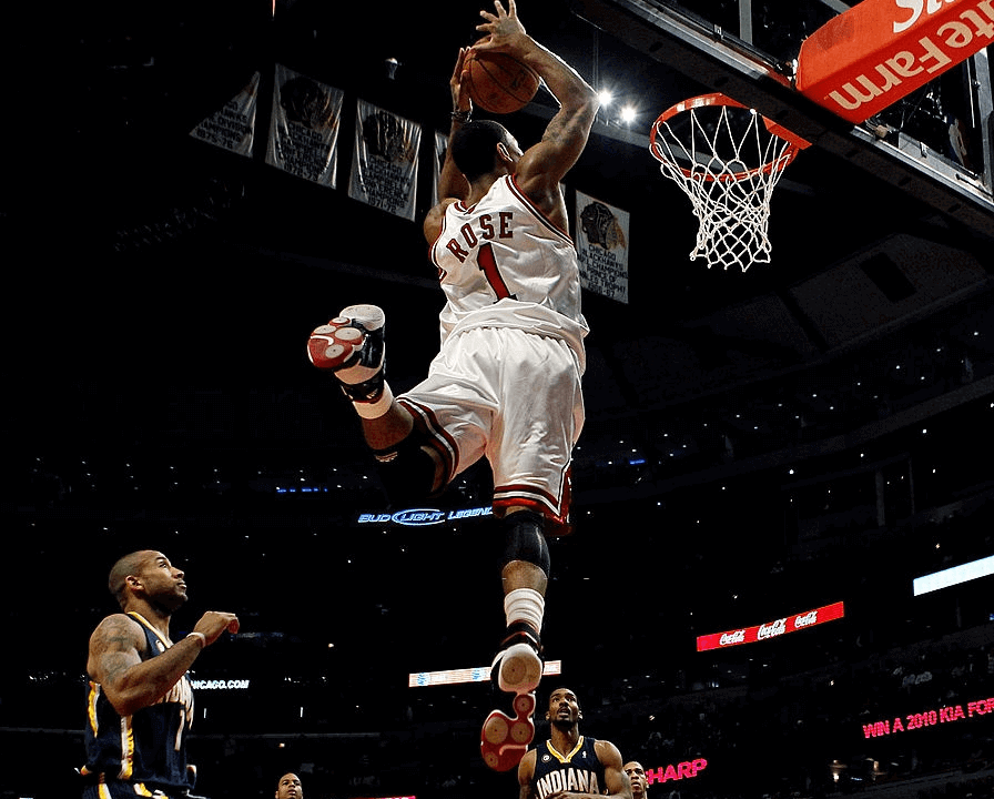 Derrick Rose #1 of the Chicago Bulls takes a pass and leaps to dunk the ball against the Indiana Pacers at the United Center on February 24, 2010 in Chicago, Illinois.