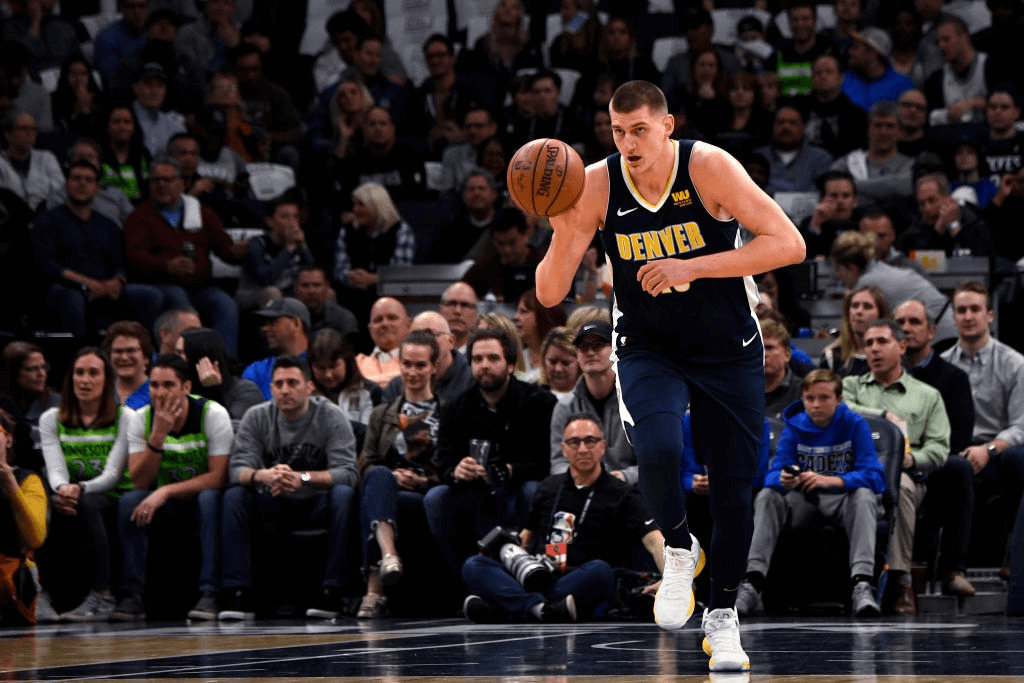 MINNEAPOLIS, MN - APRIL 11: Denver Nuggets center Nikola Jokic (15) takes the ball up the court in the regular-season finale vs the Minnesota Timberwolves at the Target Center in downtown Minneapolis. April 11, 2018 Minneapolis, Minnesota.