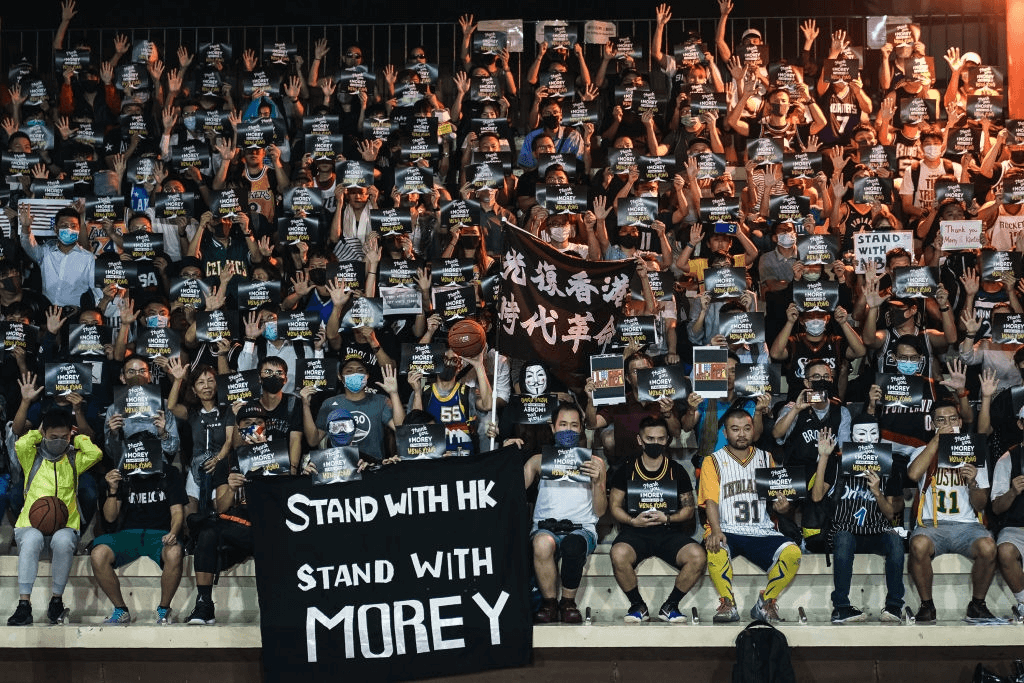 """ONG KONG, CHINA - OCTOBER 15: Hundreds of basketball fans gather in Wan Chai Southorn Playground to show support of the Houston Rockets general manager, Daryl Morey and league's commissioner, Adam Silver on October 15, 2019 in Hong Kong, China. Anti-government demonstrations in Hong Kong stretched into its fifth month after the Chinese territory's government invoked emergency powers earlier this month to introduce an anti-mask law. Protesters continue to call for Hong Kong's Chief Executive Carrie Lam to meet their remaining demands since the controversial extradition bill was withdrawn, which includes an independent inquiry into police brutality, the retraction of the word """"riot"""" to describe the rallies, and genuine universal suffrage as the territory faces a leadership crisis."""