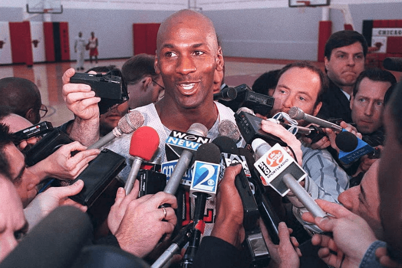 CHICAGO, IL - MARCH 20: Basketball star Michael Jordan of the Chicago Bulls talks to the press 20 March after practice at the Berto Center in Deerfield, Illinois. Jordan reiterated that he has returned to basketball because of his love for the game.