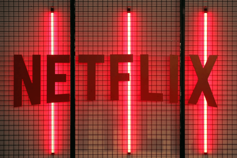 PARIS, FRANCE - NOVEMBER 02: Netflix logo is displayed during the 'Paris Games Week' on November 02, 2017 in Paris, France. Netflix is an American company offering streaming movies and TV series on the Internet. 'Paris Games Week' is an international trade fair for video games and runs from November 01 to November 5, 2017.