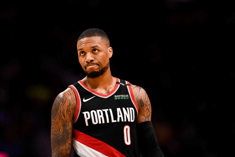DENVER, CO - MAY 7: Damian Lillard (0) of the Portland Trail Blazers shows signs of frustration against the Denver Nuggets during the third quarter on Tuesday, May 7, 2019. The Denver Nuggets versus the Portland Trail Blazers in game five of the teams' second round NBA playoff series at the Pepsi Center in Denver.