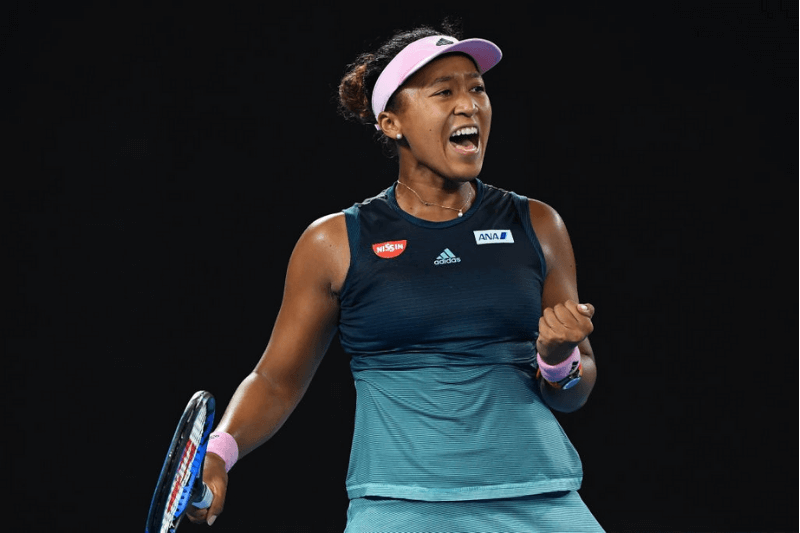 MELBOURNE, AUSTRALIA - JANUARY 24: Naomi Osaka of Japan celebrates in her Women's Semi Final match against Karolina Pliskova of Czech Republic during day 11 of the 2019 Australian Open at Melbourne Park on January 24, 2019 in Melbourne, Australia