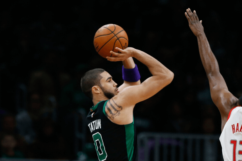 Feb 29, 2020; Boston, Massachusetts, USA; Boston Celtics forward Jayson Tatum (0) shoots over Houston Rockets guard James Harden (13) during the second quarter at TD Garden.