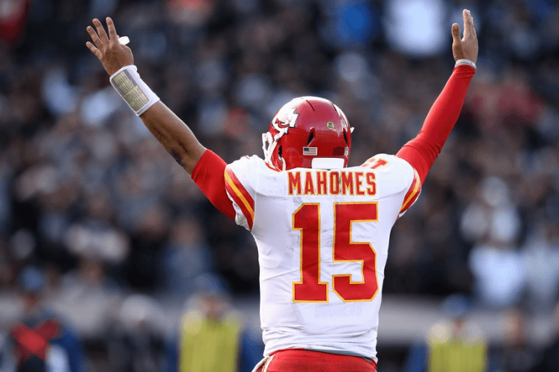OAKLAND, CA - DECEMBER 02: Patrick Mahomes #15 of the Kansas City Chiefs celebrates after a touchdown by Spencer Ware #32 against the Oakland Raiders during their NFL game at Oakland-Alameda County Coliseum on December 2, 2018 in Oakland, California