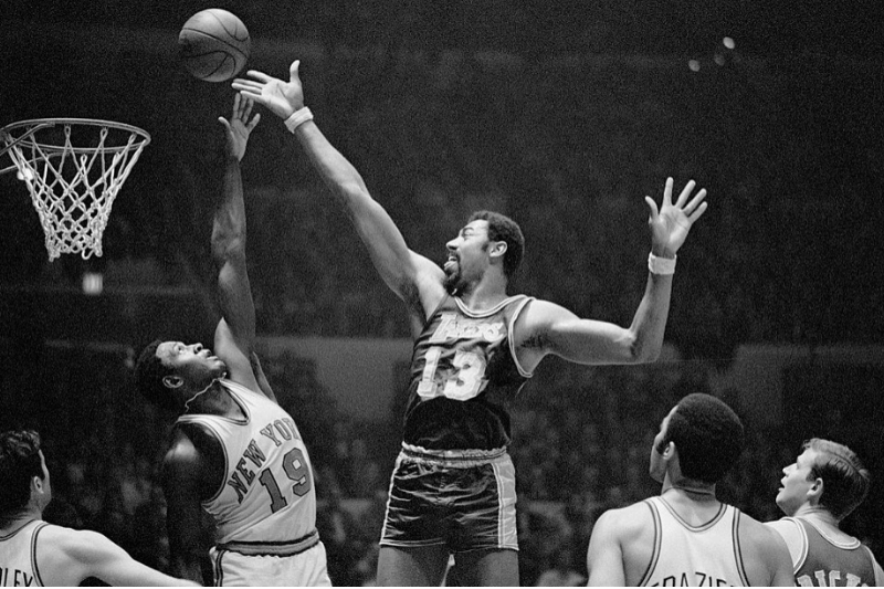 Fingertips New York: Wilt Chamberlain (#13) of the Los Angeles Lakers and Willis Reed (#19) of the New York Knickerbockers go after a rebound during game at Madison Square Garden here Feb. 18th. Chamberlain scored 31 points to lead the Lakers to a 113-109 victory over the Knicks and crack the Knicks' 11-game winning streak.