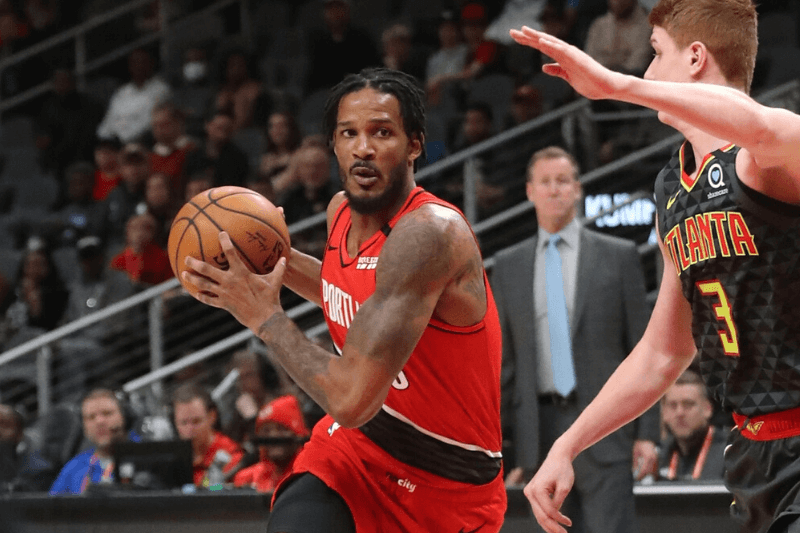 Feb 29, 2020; Atlanta, Georgia, USA; Portland Trail Blazers forward Trevor Ariza (8) drives against Atlanta Hawks guard Kevin Huerter (3) in the first quarter at State Farm Arena.