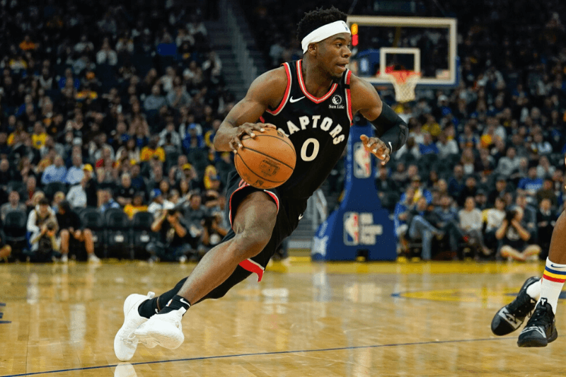 Mar 5, 2020; San Francisco, California, USA; Toronto Raptors guard Terence Davis (0) drives the ball against the Golden State Warriors during the second quarter at Chase Center.