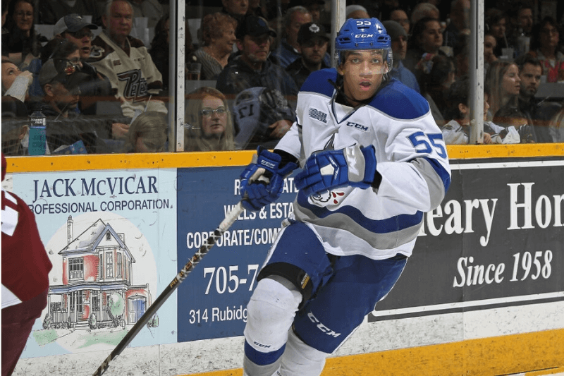 PETERBOROUGH, ON - MARCH 16: Quinton Byfield #55 of the Sudbury Wolves skates against the Peterborough Petes during an OHL game at the Peterborough Memorial Centre on March 16, 2019 in Peterborough, Ontario, Canada. The Wolves defeated the Petes 3-1.