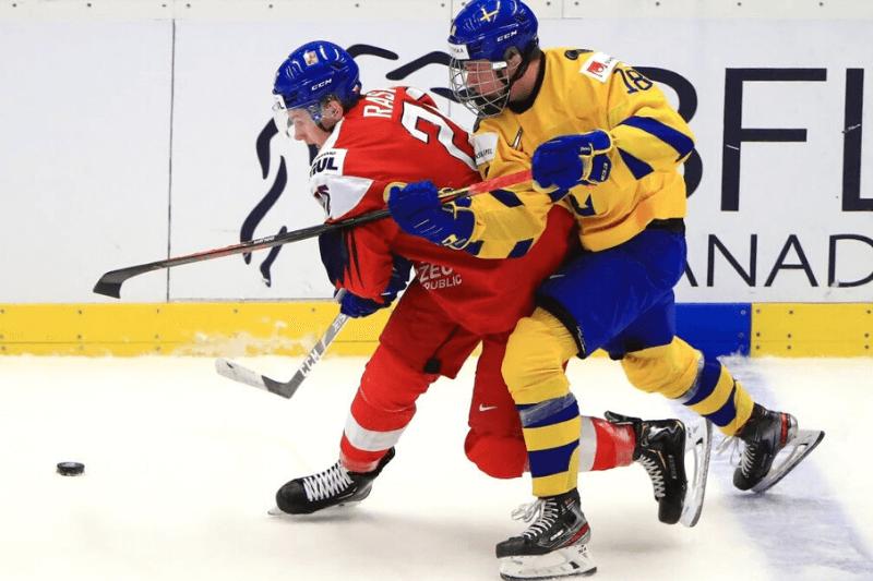 OSTRAVA, CZECH REPUBLIC - JANUARY 2, 2020: The Czech Republics Adam Raska (L) and Swedens Lucas Raymond in their 2020 IIHF World Junior Ice Hockey Championship quarter-final match at Ostravar Arena.
