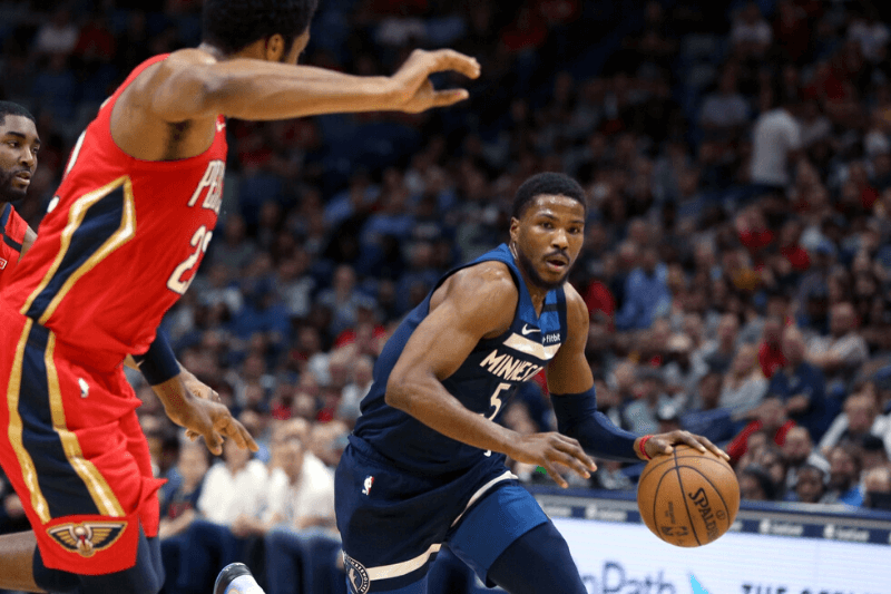 Mar 3, 2020; New Orleans, Louisiana, USA; Minnesota Timberwolves guard Malik Beasley (5) is defended by New Orleans Pelicans center Derrick Favors (22) in the second quarter at the Smoothie King Center.