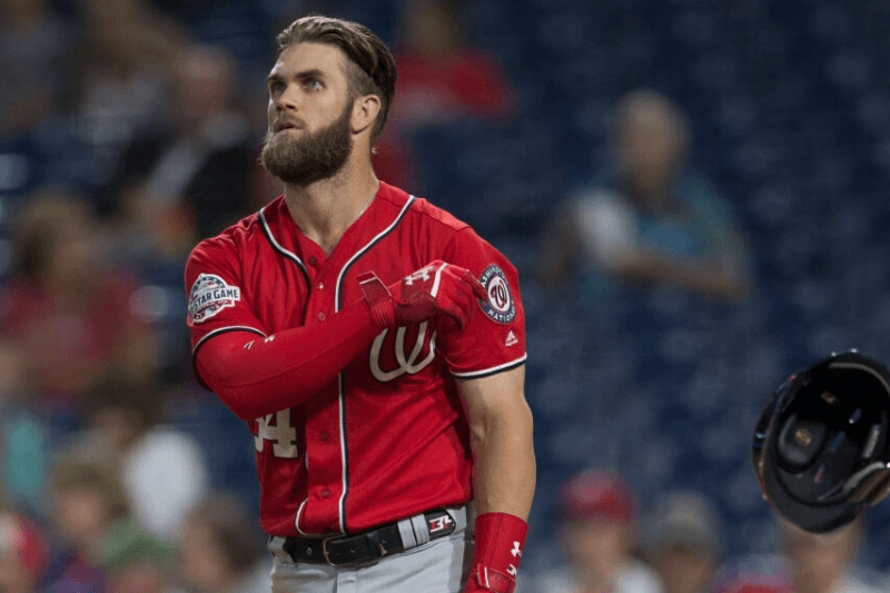 PHILADELPHIA, PA - SEPTEMBER 11: Bryce Harper #34 of the Washington Nationals tosses his helmet after striking out to end the first inning against the Philadelphia Phillies in game two of the doubleheader at Citizens Bank Park on September 11, 2018 in Philadelphia, Pennsylvania.