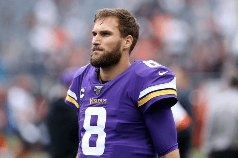 CHICAGO, ILLINOIS - SEPTEMBER 29: Kirk Cousins #8 of the Minnesota Vikings warms up before the game against the Chicago Bears at Soldier Field on September 29, 2019 in Chicago, Illinois.